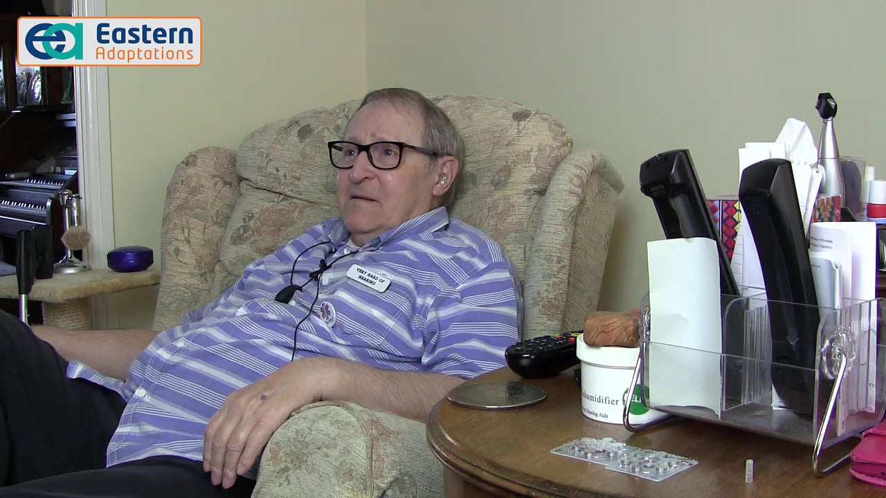 Man (Ralph Bristol) sitting in his lounge armchair